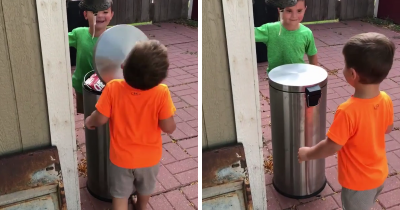 Two Boys Jokingly Hitting Each Other With A Trash Can Lid