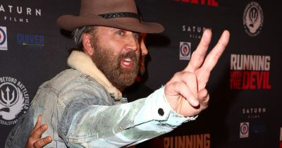 Nicolas Cage showed up unrecognizable with shaggy beard on film premiere for 'Running with the Devil'.