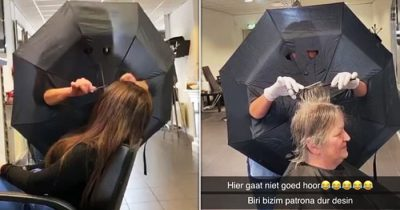 Hairdresser Creates Barrier Between Clients By Cutting Arm And Eye Holes In Umbrella