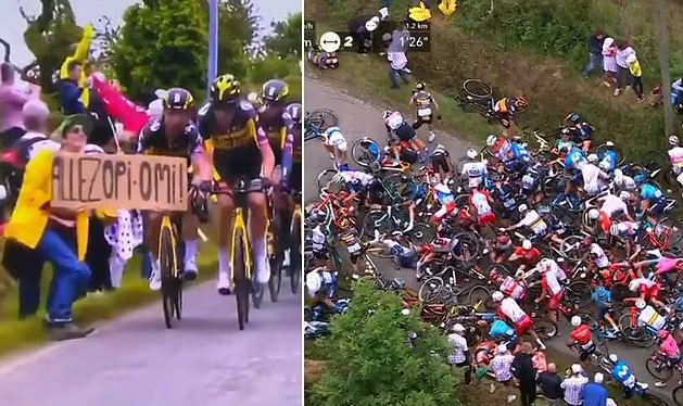 Spectator With A Sign Causes A Huge Pile-Up At The Tour De France